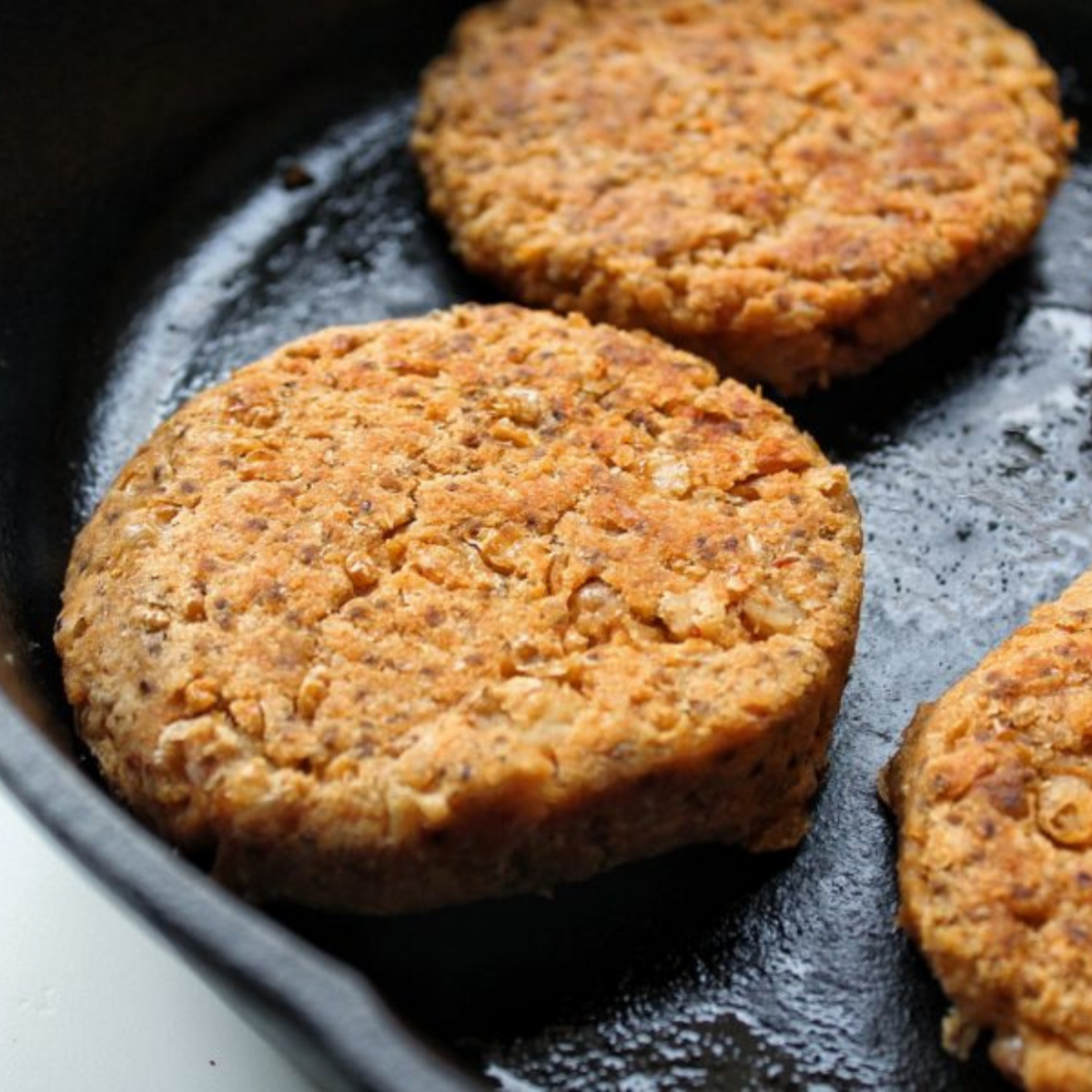 Cannellini bean veggie burger in cast-iron skillet