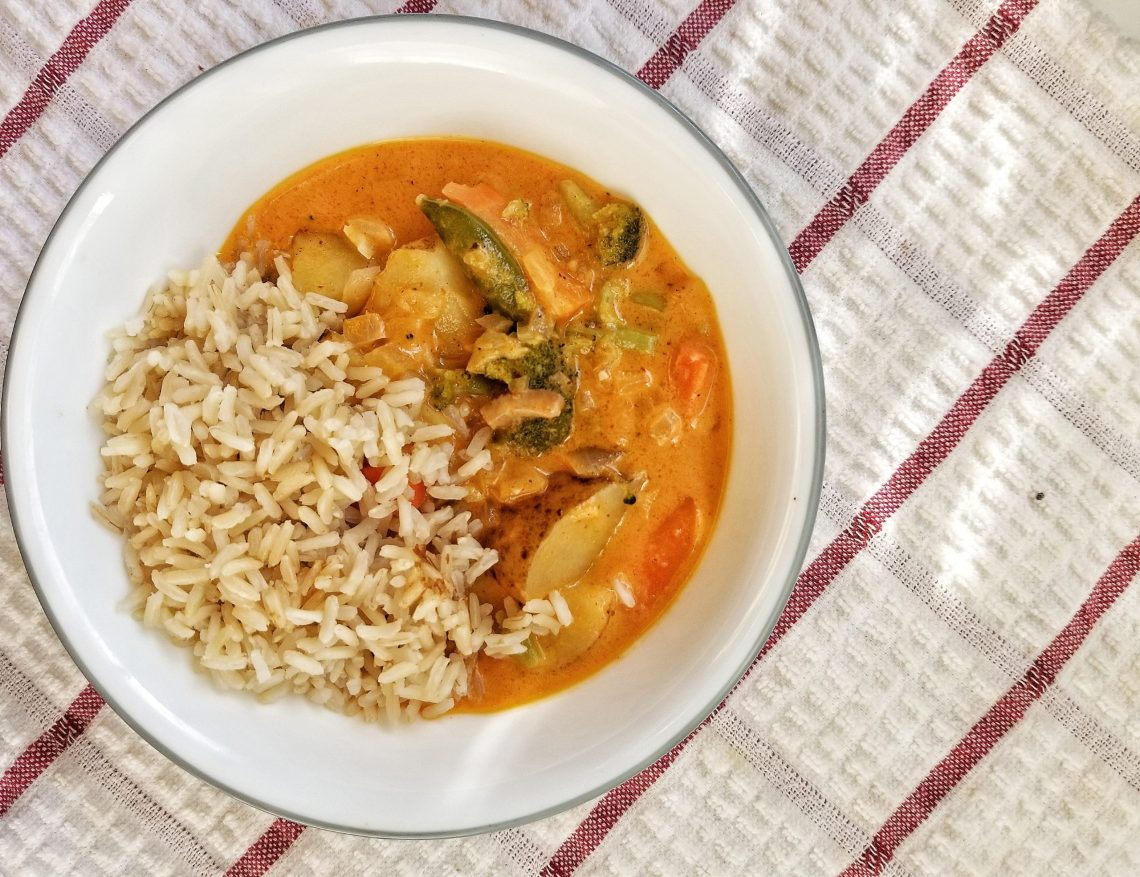 Vegetable Thai-style curry with a side of brown rice