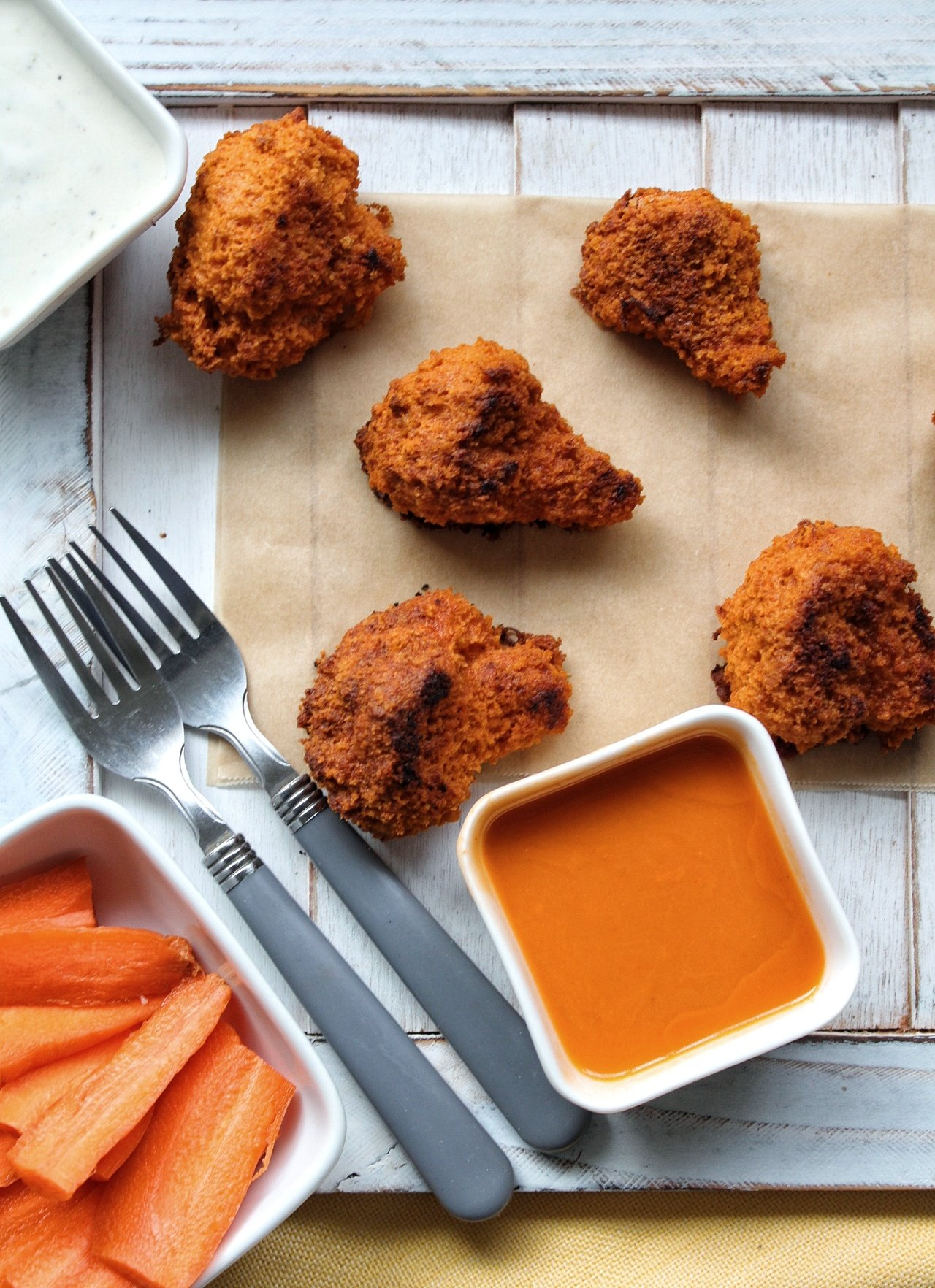 buffalo cauliflower wings with sauce and carrots