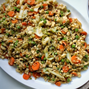 """Oil-free """"fried"""" rice with veggies served on a platter"""