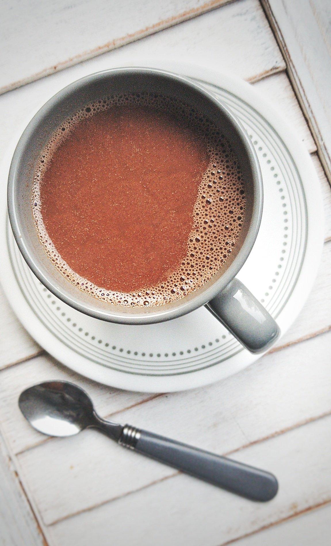 Mug filled with homemade, vegan chocolate milk or hot cocoa