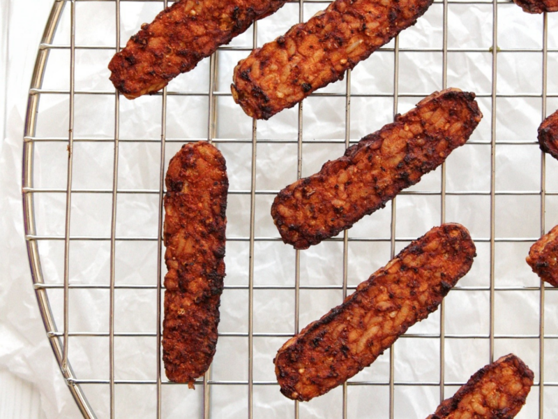 Air fryer tempeh bacon on a cooling rack