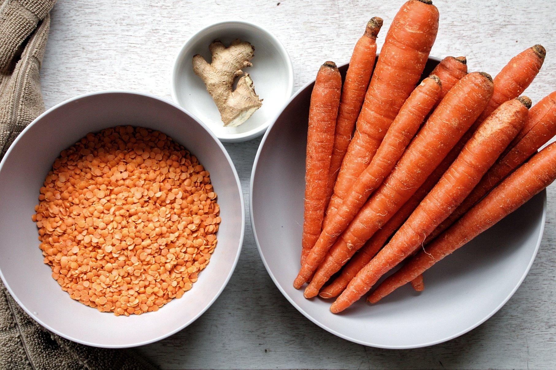 Ingredients for soup: red split lentils, ginger, and carrots