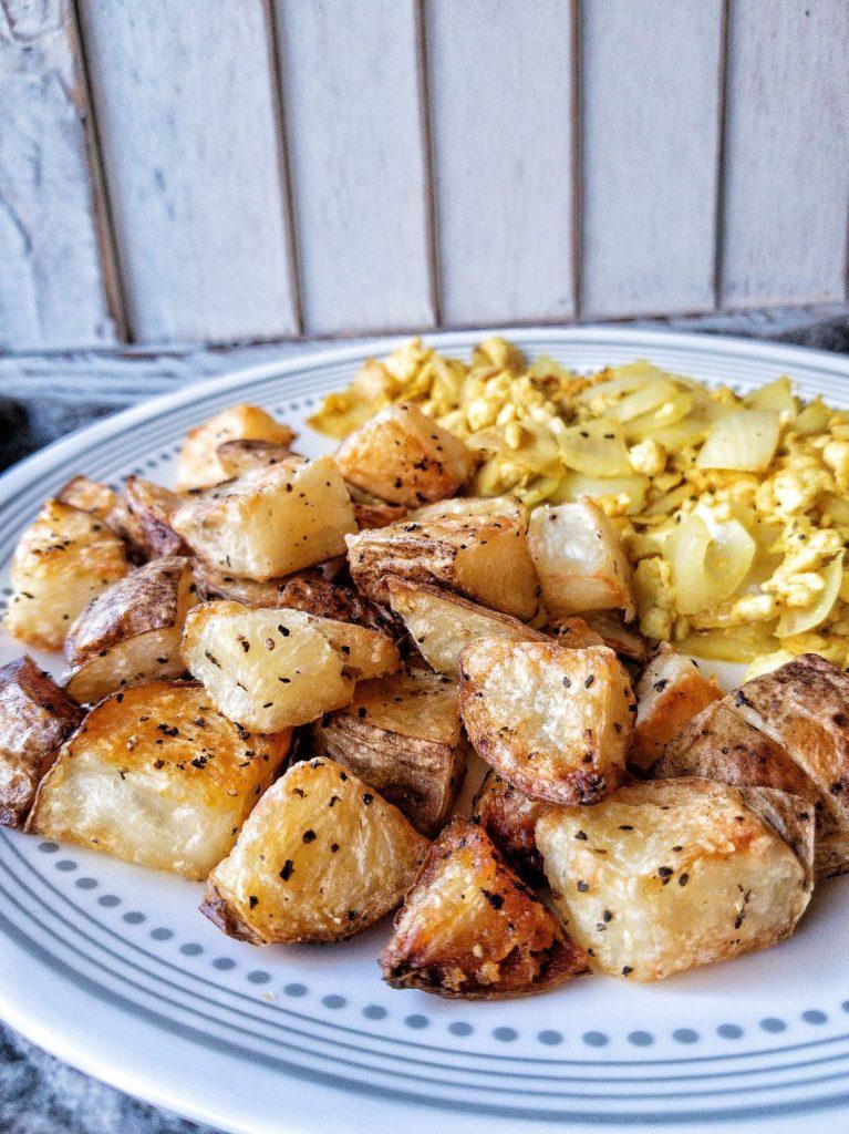 Crispy, roasted breakfast potatoes with a side of scrambled tofu