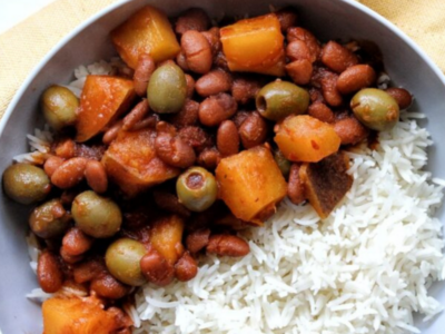 Puerto Rican habichuelas guisadas with a side of rice