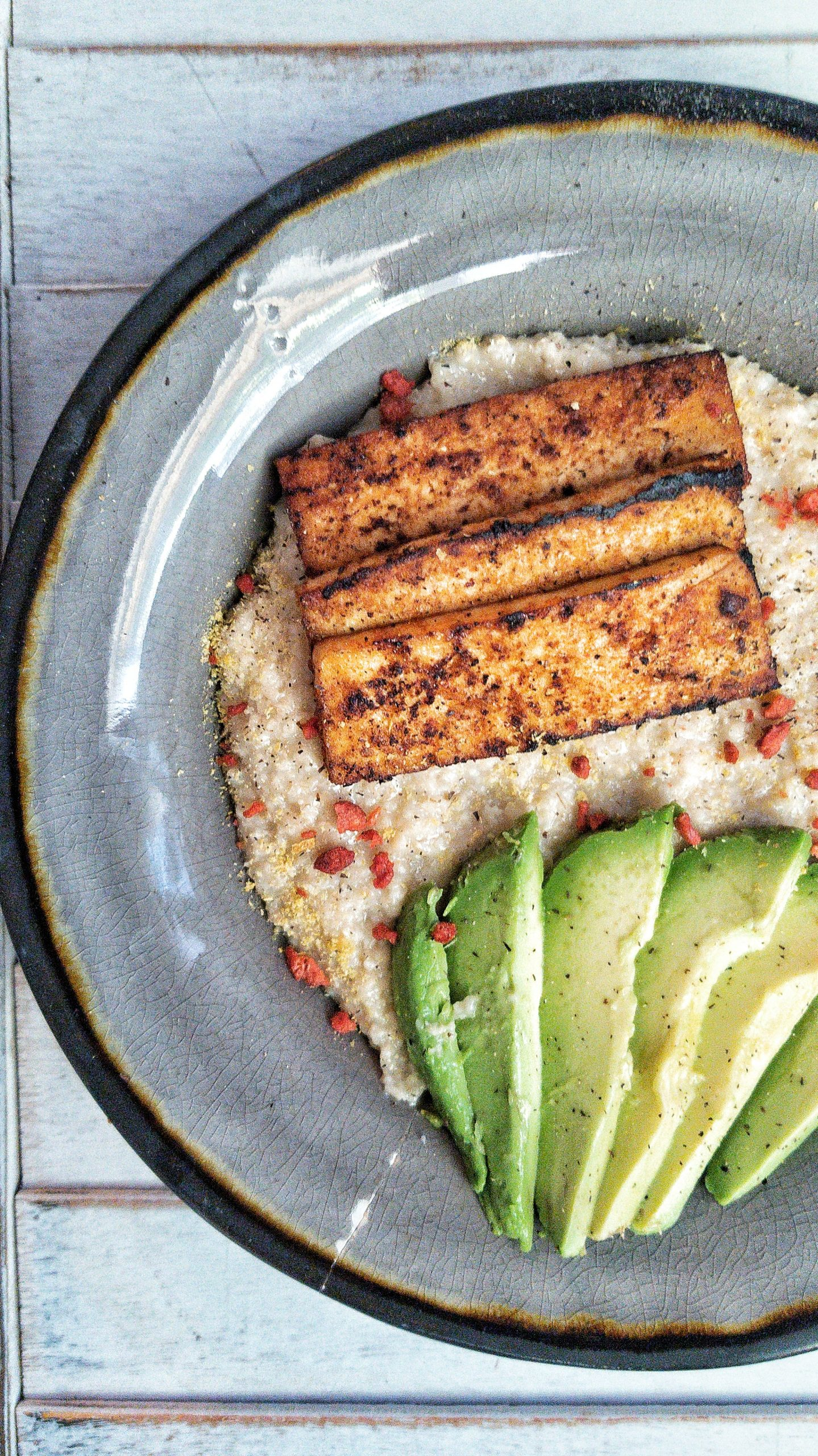 Oat bran with tofu and sliced avocado