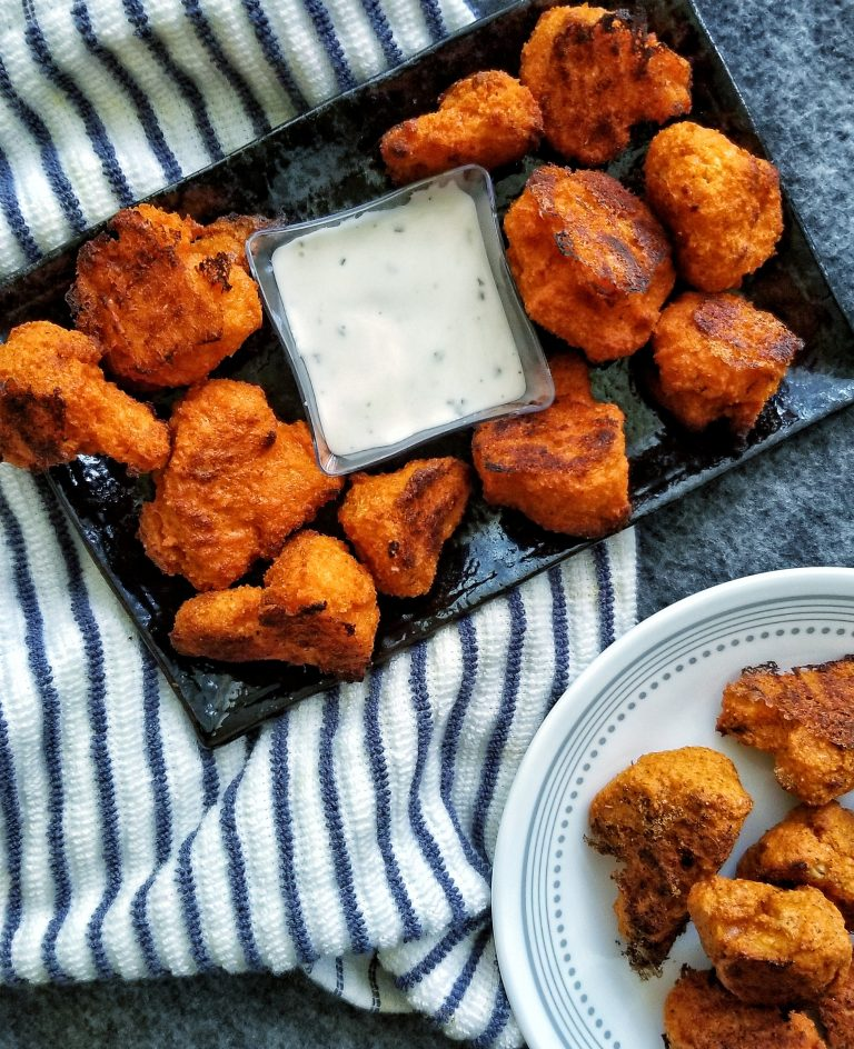 Oven-baked buffalo cauliflower wings with a vegan dip