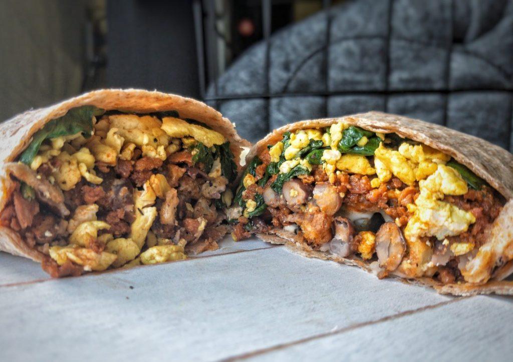 Breakfast burrito stuffed with scrambled tofu, soyrizo, black beans, and kale.