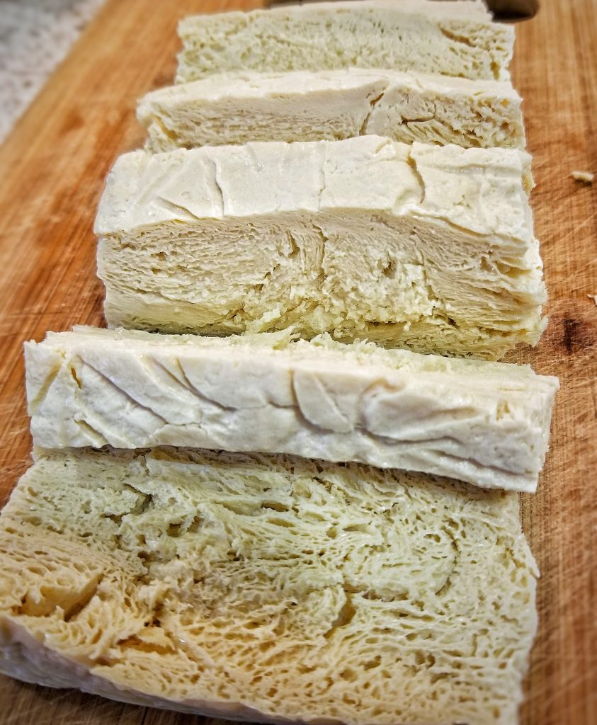 Large slab of porous, defrosted tofu