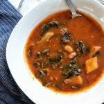 Collard greens and pinto beans soup with Latin flavors