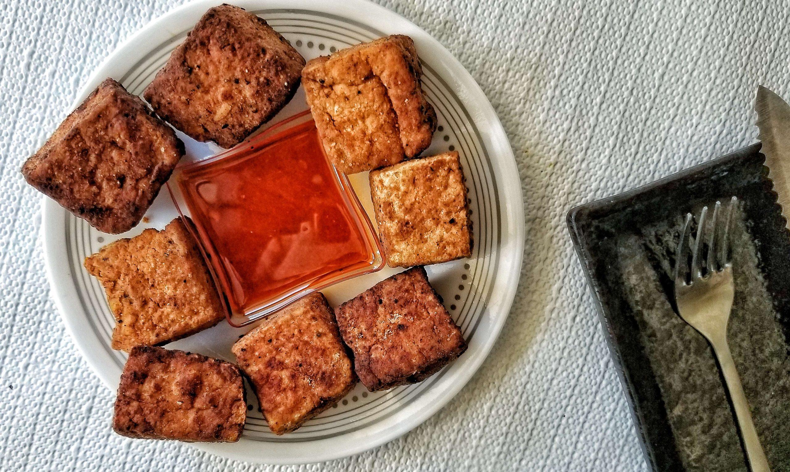 Large chunks of pan-fried firm tofu