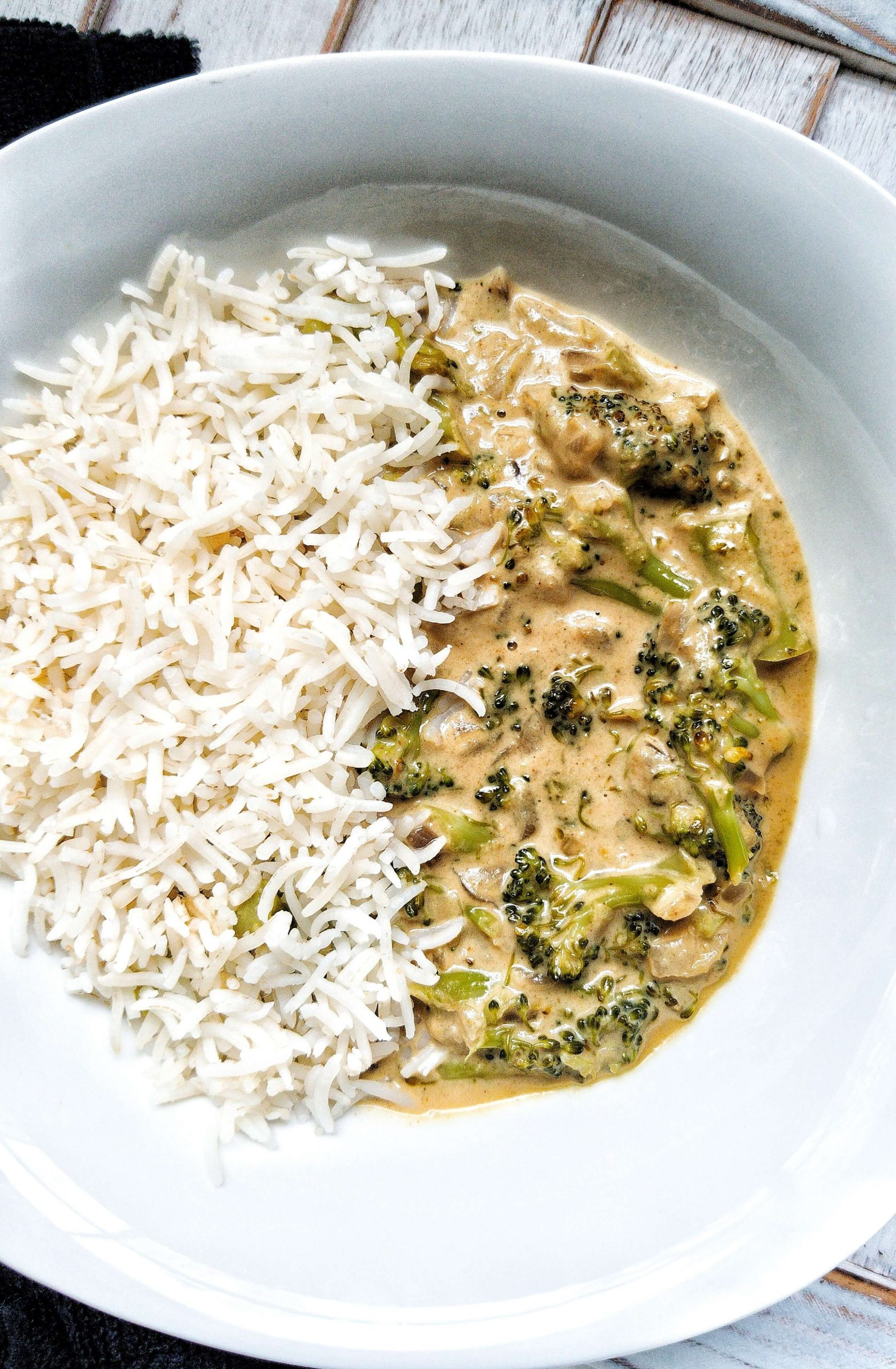 creamy vegan broccoli curry with a side of white rice