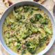 Bowl of vegetable broccoli curry with flatbread.