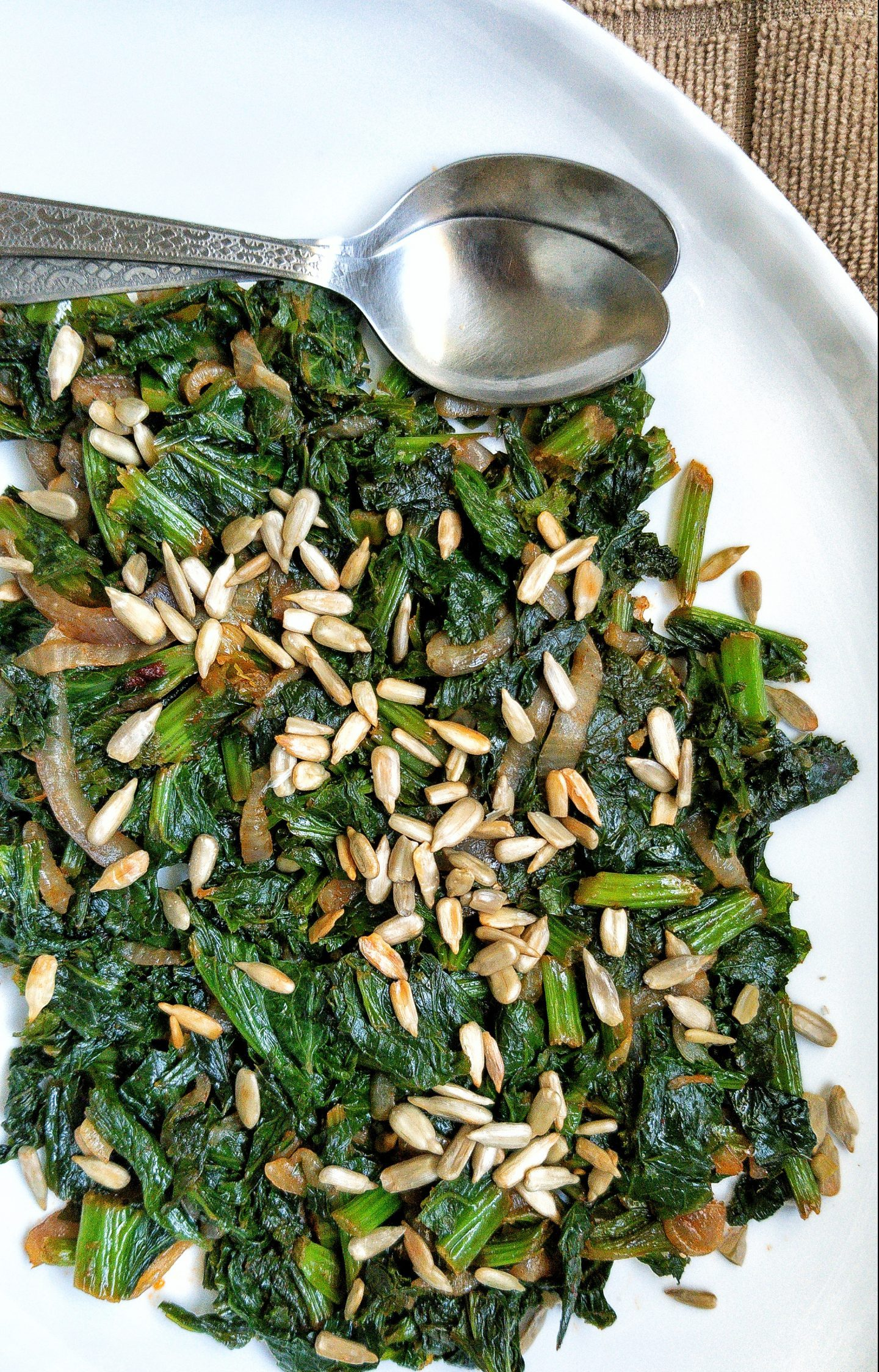 Pan-cooked curly mustard greens with lightly salted roasted sunflower seeds