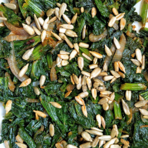 Pan-cooked curly mustard greens with lightly salted roasted sunflower seeds.