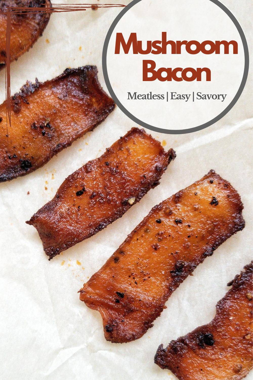 Golden king oyster mushroom bacon on parchment paper. Pinnable for Pinterest.