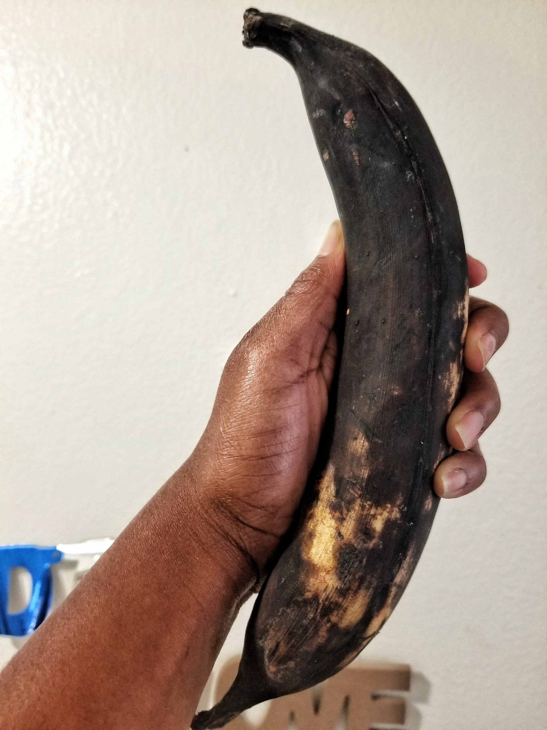 """Very ripe sweet plantain or """"maduros"""" covered in a mostly black skin."""
