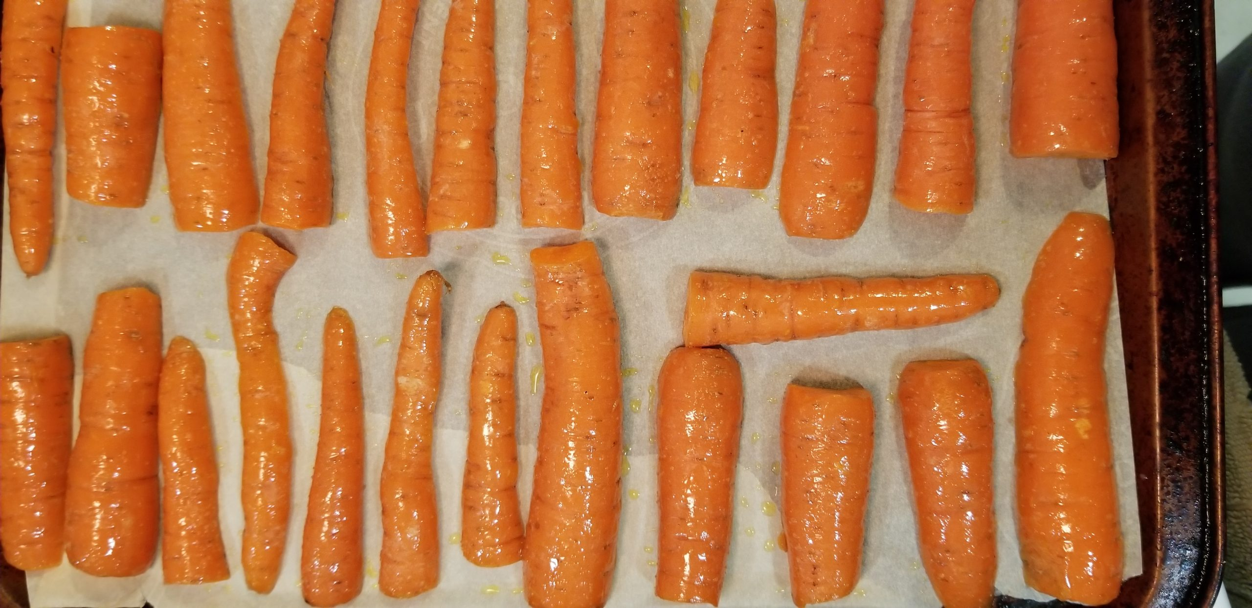 Chopped carrots on a baking tray lined with parchment papper