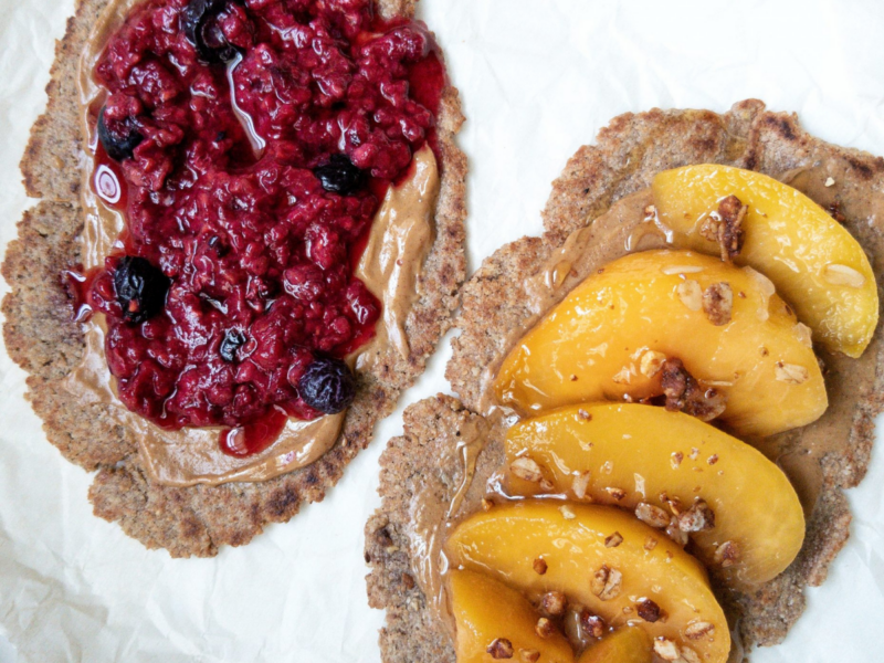 Cinnamon brown sugar flatbread. One flatbread topped with mixed berries and the other with ripe peaches, granola, and honey.