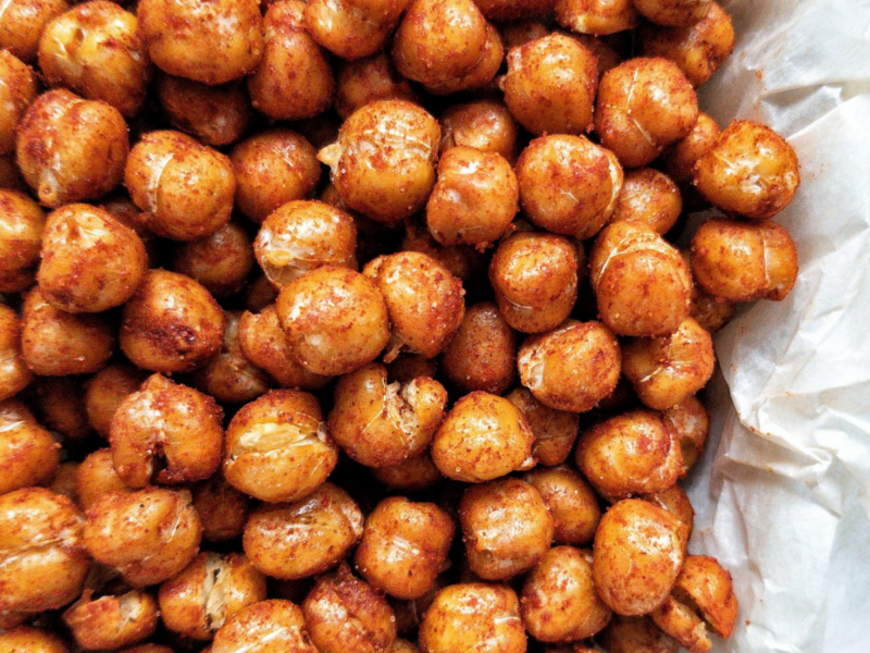 Crispy chickpeas seaoned with paprika on parchment paper