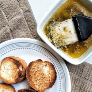 Bread with a side of melted garlic butter dipping sauce
