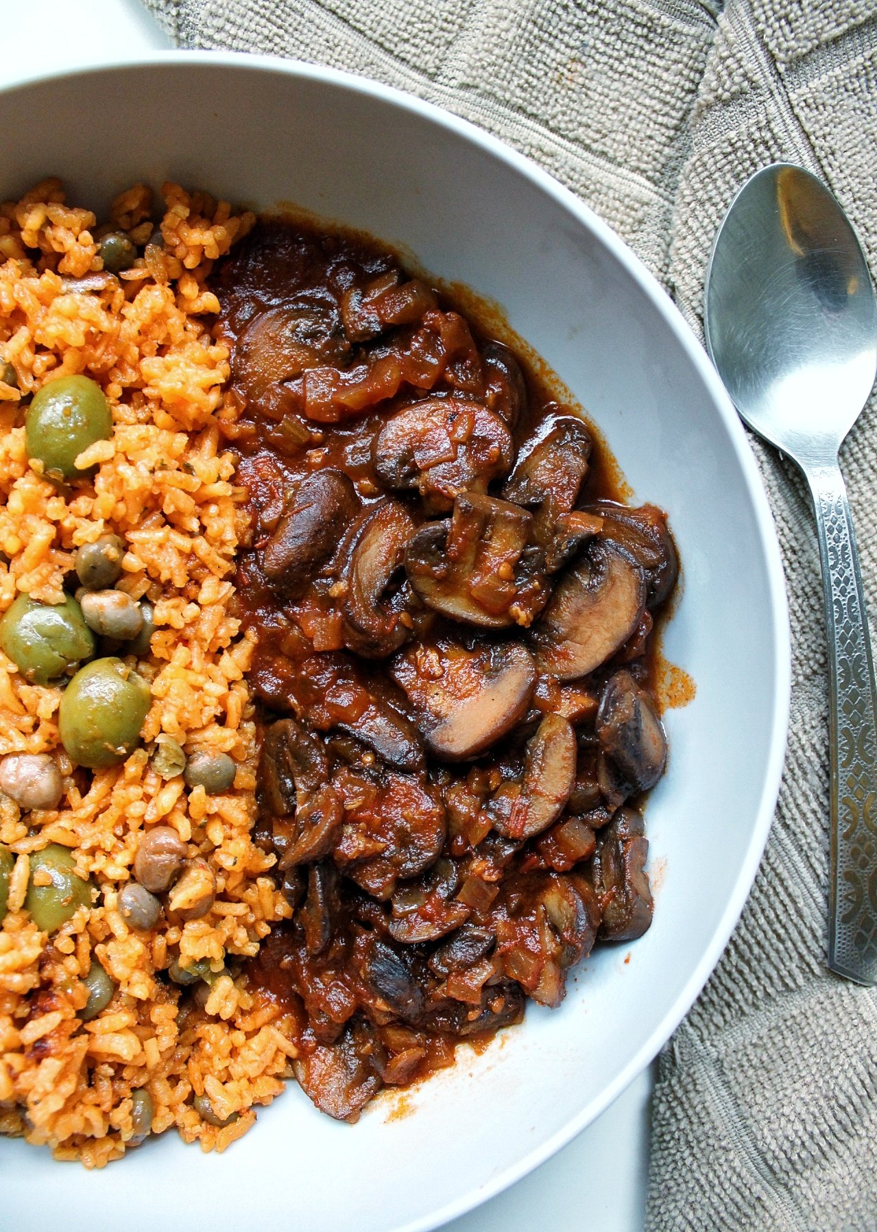 Tomato braised mushrooms with a side of yellow Puerto Rican rice