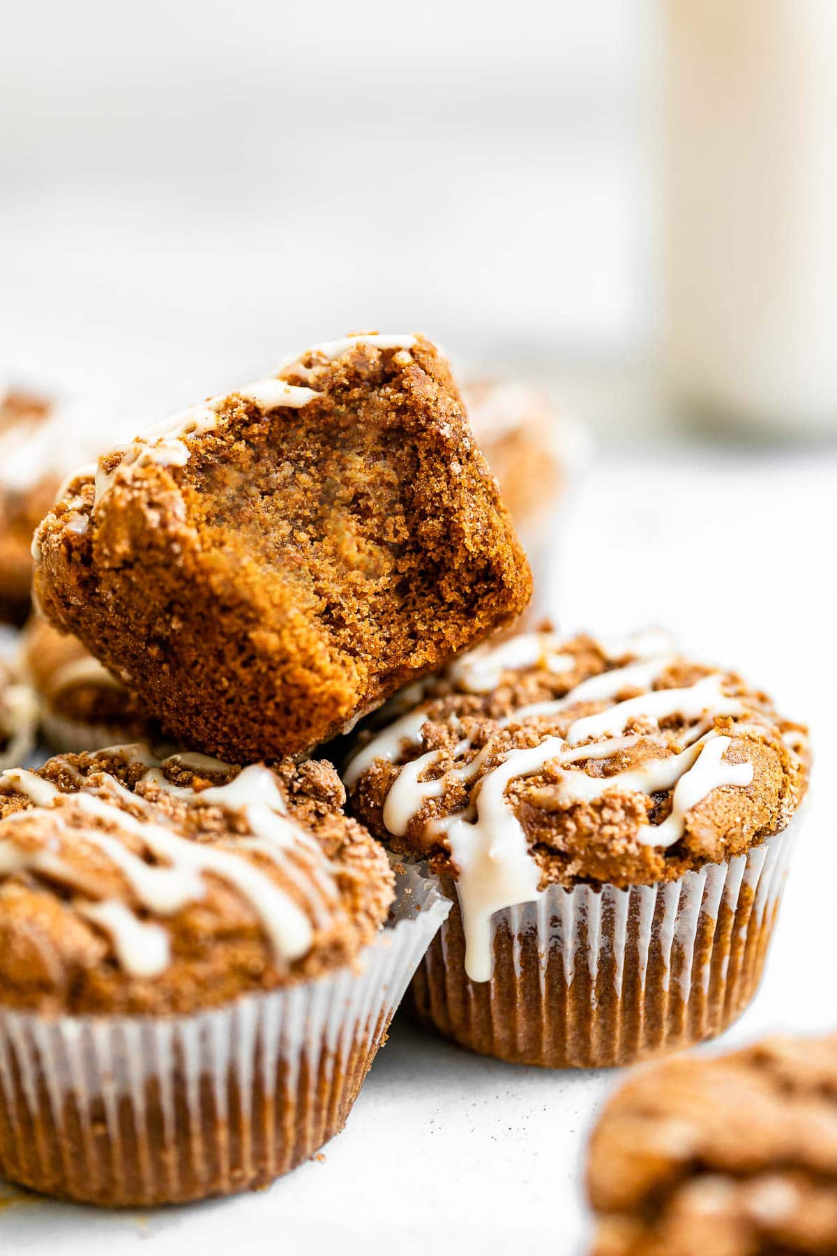 Stacked gingerbread muffin with an icing drizzle