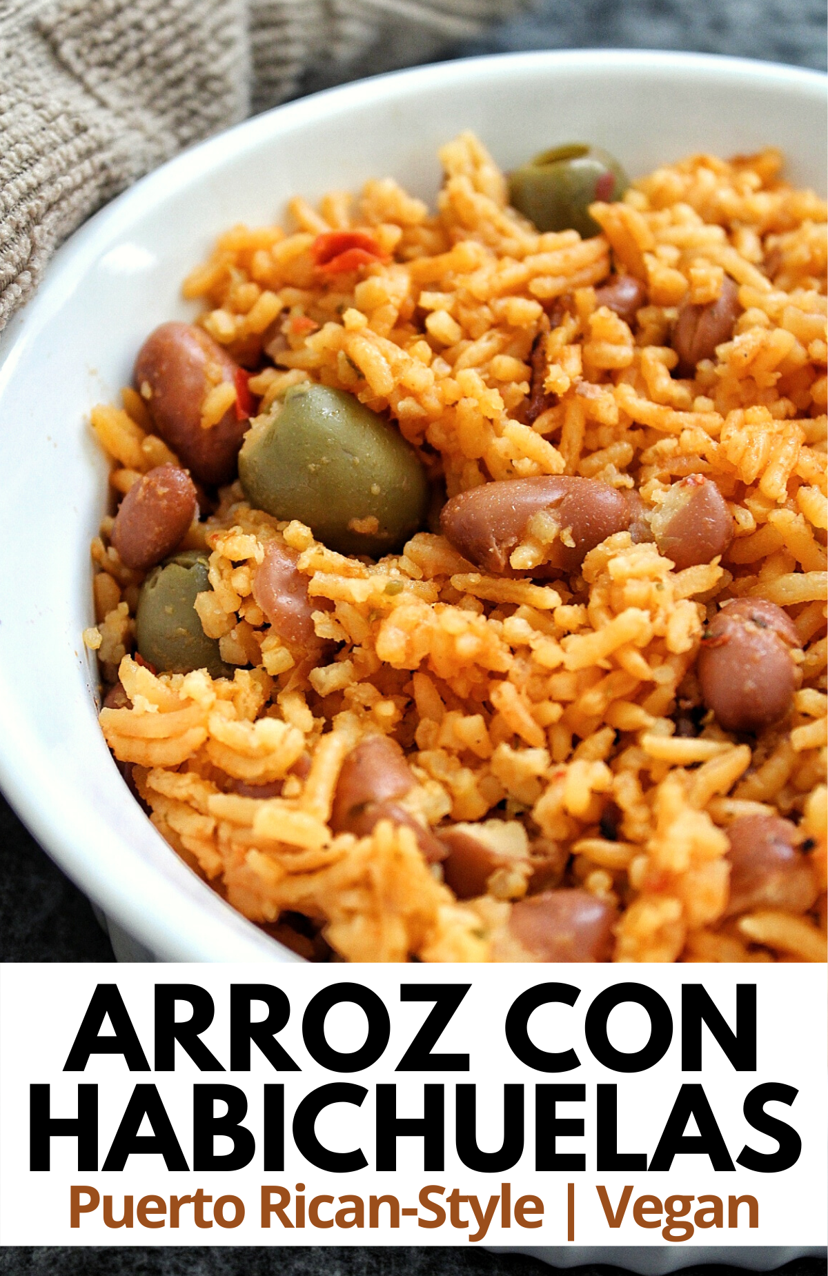 Pueto Rican yellow rice with pink beans made with sofrito, tomato sauce, and seasoning.