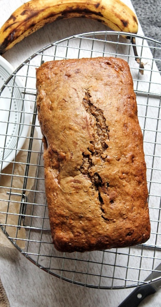 Loaf of banana bread on a metal wire cooling rack