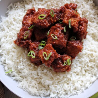 Saucy smoked tempeh cooked in a chiptole sauce and served on a bed of rice