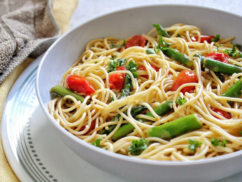 Springtime spaghetti pasta with asparagus and tomatoes