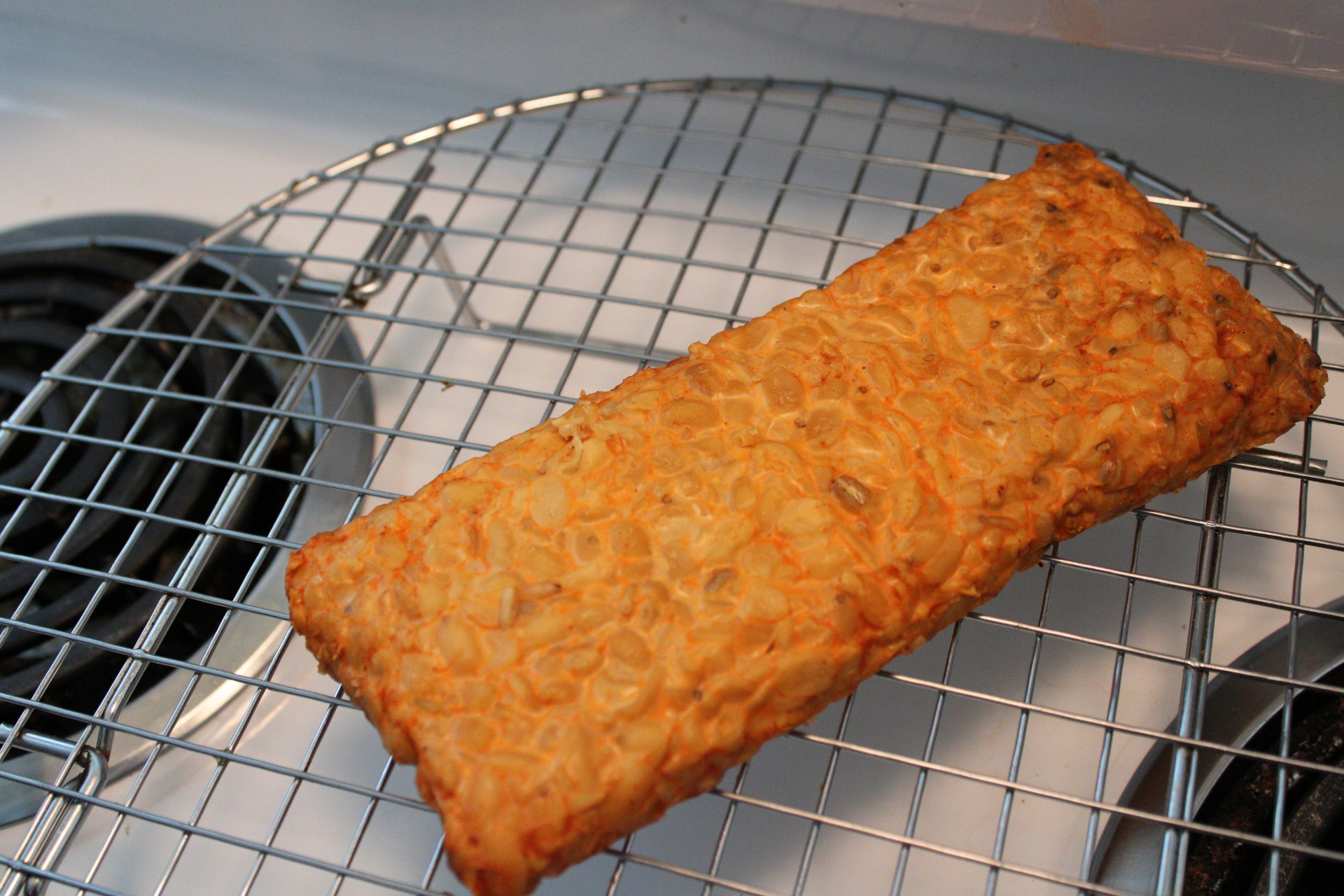 Steamed, flavored tempeh on a cooling rack