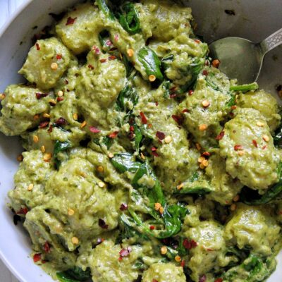 Gnocchi pasta dumplings with pesto and creamy cashew sauce and spinach