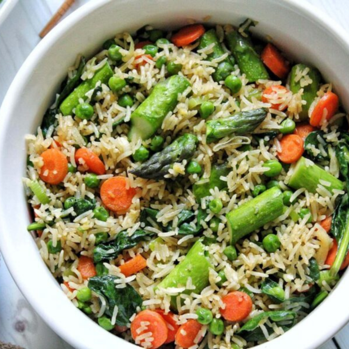 Spring fried rice with asparagus, carrots, and peas.