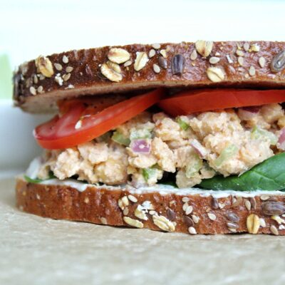 Vegan chickpea salad with tomatoes and spinach