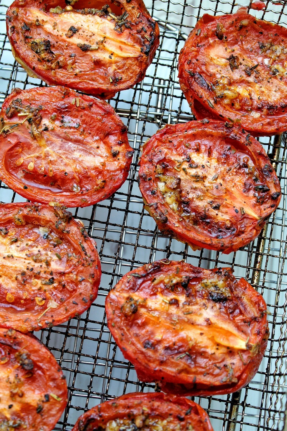 Up close tomato halves roasted with olive oil and Italian herbs