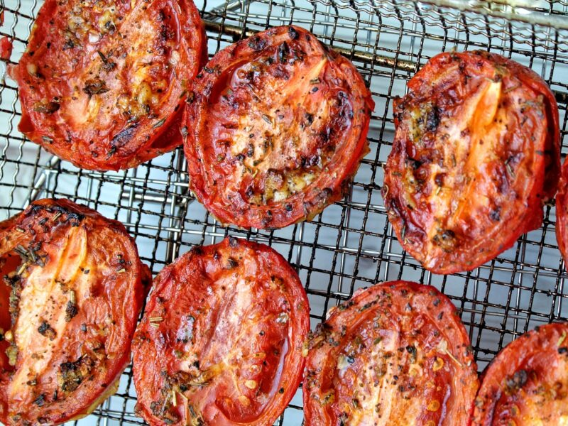 Roma tomatoes roasted on an air fryer rack