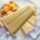 Mango coconut popsicle with frozen mango in background