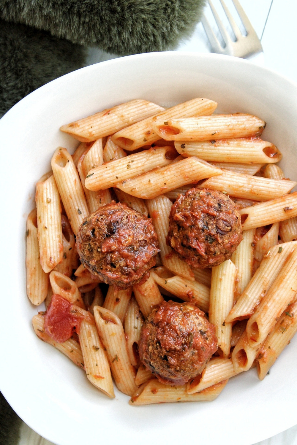 Veggie lentil meatballs with penne pasta in a bowl
