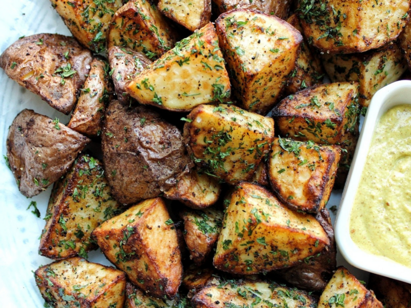 Air fryer red potatoes with herbs and sideof sauce