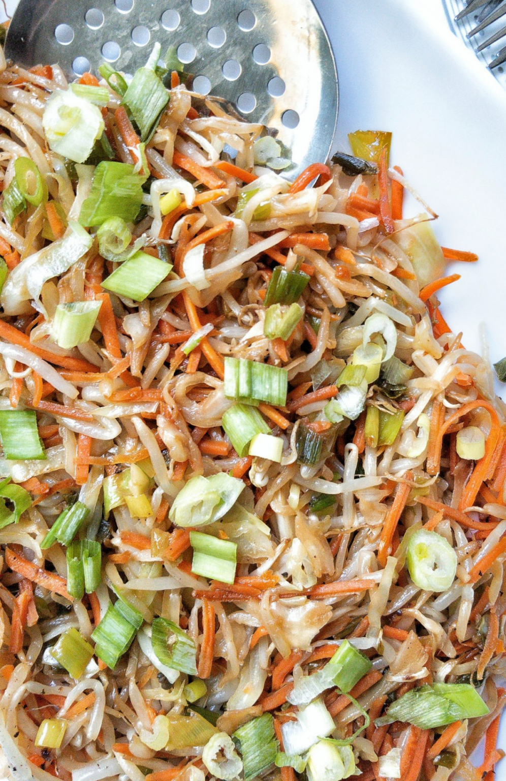 Mung bean sprouts with vegetables on a platter.