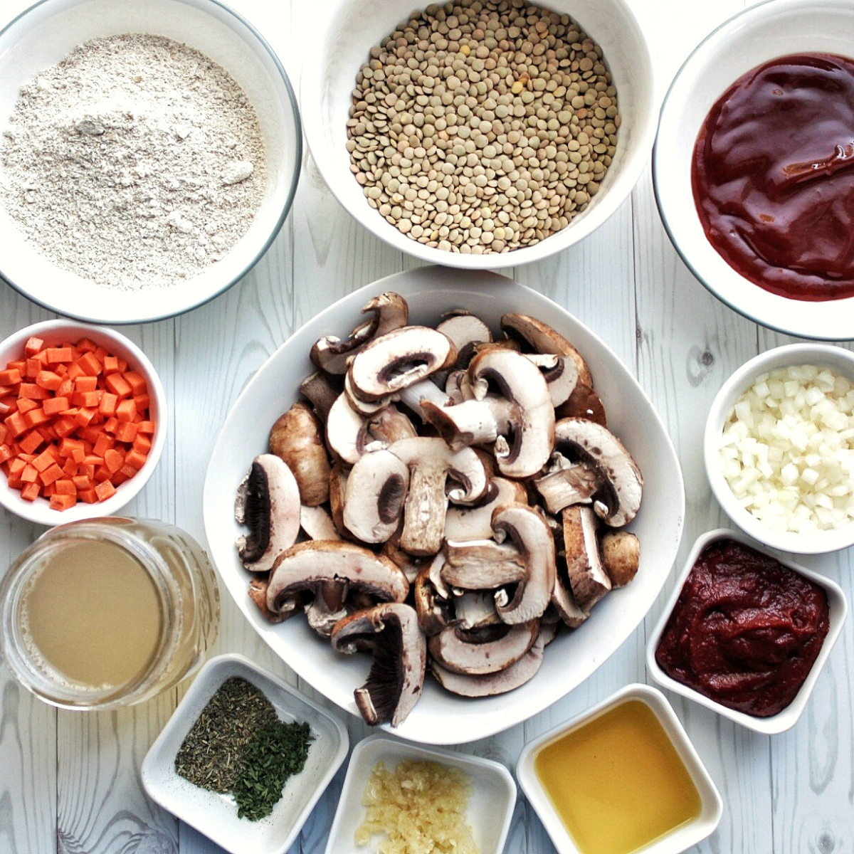 Dry lentils, glaze sauce, chopped onion, carrots, mushroom, mushroom broth, Italian seasoning, dried parsley, crushed garlic, olive oil, glaze, sauce, and oat flour - each in small bowls.