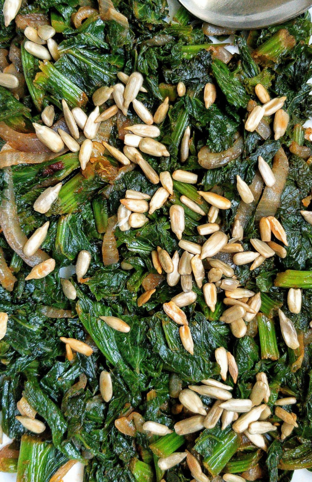 Pan-fried mustard greens with roasted sunflower seeds. #vegan #sides