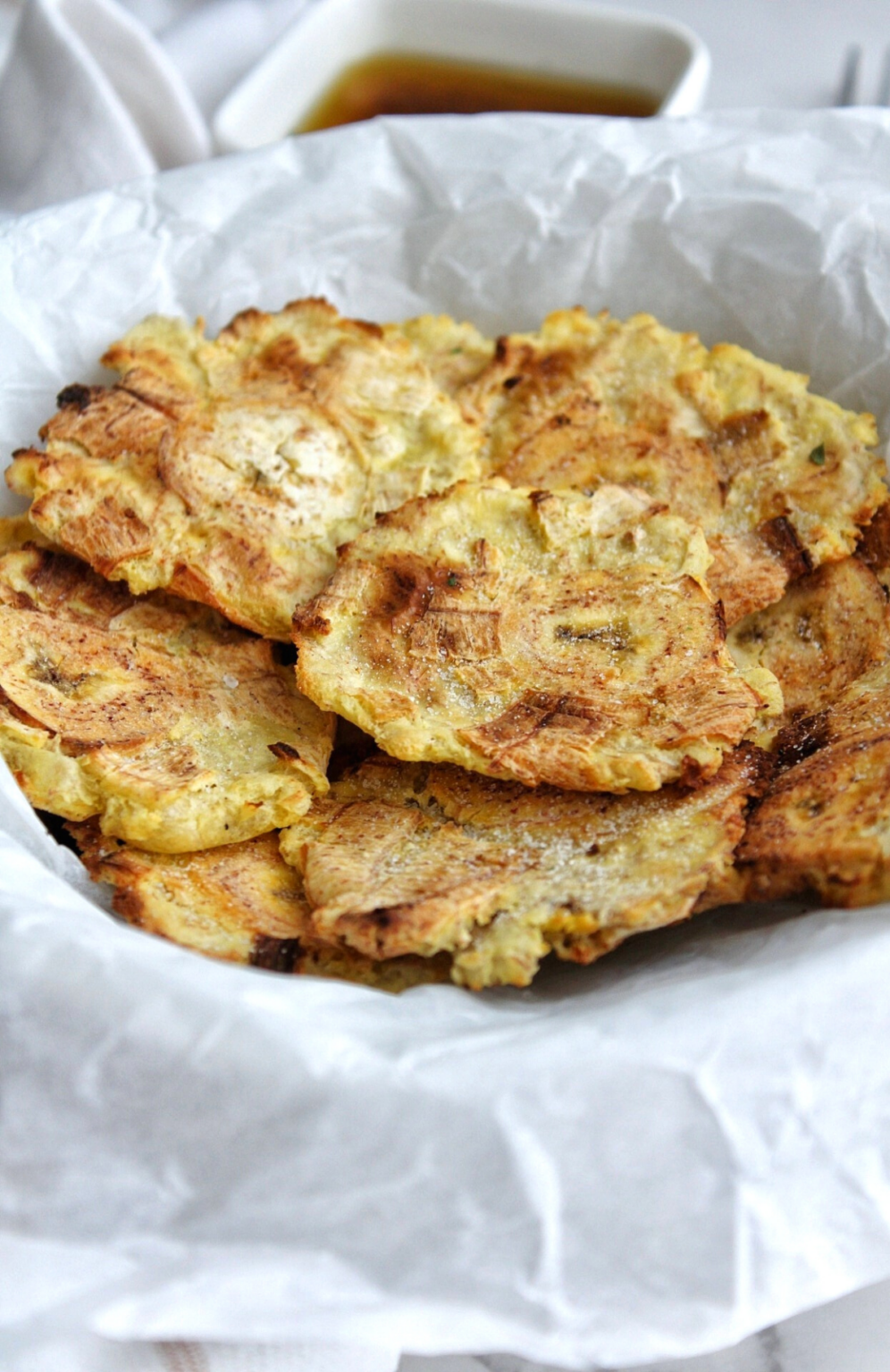 Air fryer plantains in a bowl lined with parchment paper.