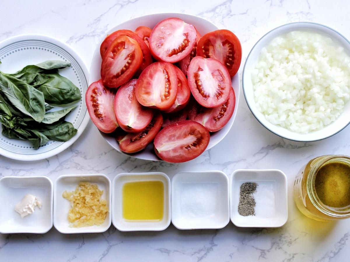 Basil leaves, Roma tomato halves, chopped onion, vegan butter, crushed garlic, olive oil, sugar, black pepper, salt, vegetable broth.