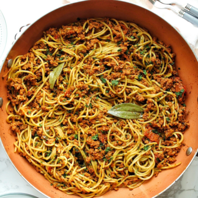 Meatless Puerto Rican spaghetti topped with chopped cilantro.