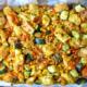 Zucchini stuffing casserole with carrots, corn, and stale bread in a casserole dish.